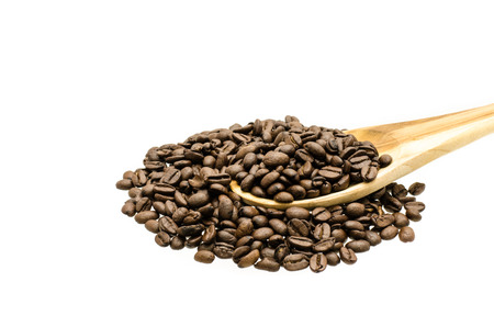 Coffee beans in  wood ladle and scattered, isolated over white background. photo