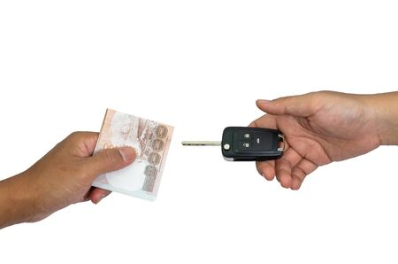 Hand with money and car keys, isolated on white background photo