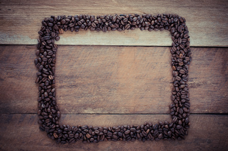 rectangle frame: Rectangle frame made of coffee beans on the wooden background