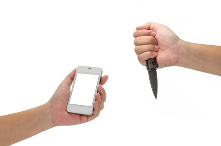one hand holding a knife and holding the phone .Concept robbery isolated on white background. photo