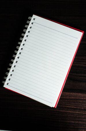 open notebook: White open notebook on beech wood background
