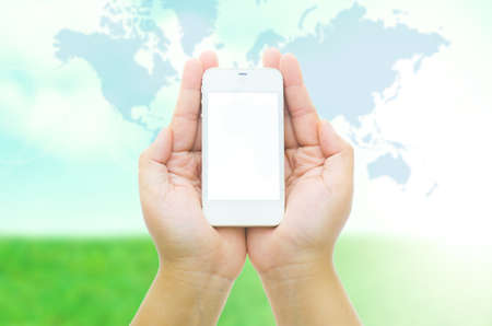 smart phone hand: Hand holding smart phone on blurred abstract nature background