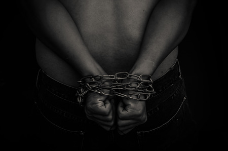 in bondage: chain hands of a man