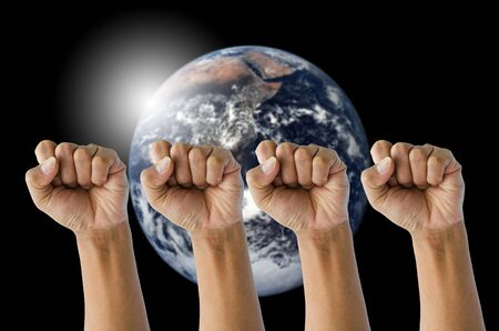 nimbi: Fist several hand with globe background concept to help the world.