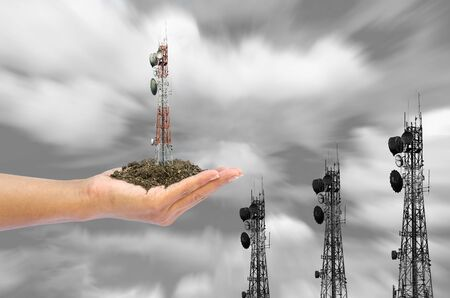 cell growth: Cell phone towers in hand with clay concept the rapid growth of technology Stock Photo