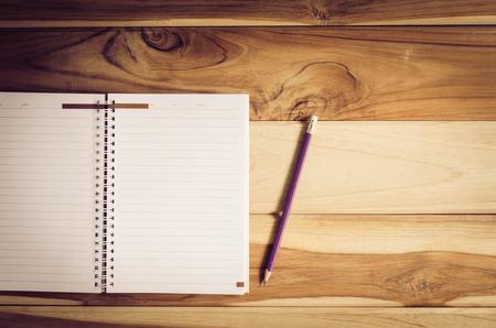 sketchbook: Color pencil and sketchbook on wood table
