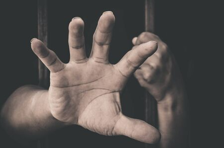 detention: A hand sticking out of a detention attempt.