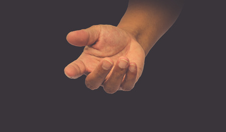 open hand on black background