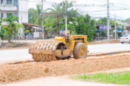 grader: Blurred image motor grader, road construction work Stock Photo