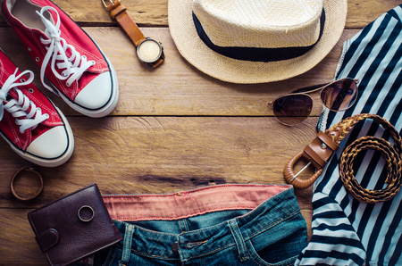 Travel accessories, clothes, wallet, glasses, phone, pasport, shoes, hat ready for travel