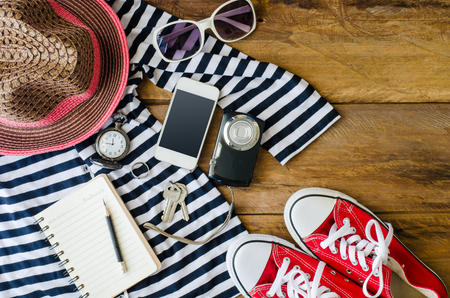 Travel accessories costumes,and notepaper for plan and The cost of  prepared for the trip Stockfoto