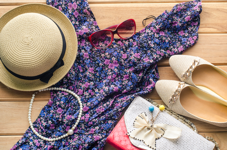 Clothing for women on the wooden floor. Ready for travel