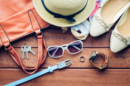 Travel Clothing accessories apparel along for women on wood