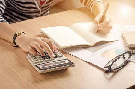 Working on a desk numerical analysis, financial accounting. Graphing Calculator Stock Photo