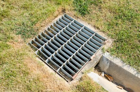 to grate: Sewer grate off the turf