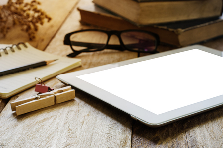 i pad: Office equipment eyeglasses ipad on the wood in the morning.