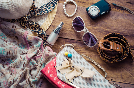 Tourism planning and equipment needed for the trip on wooden floor Stock Photo
