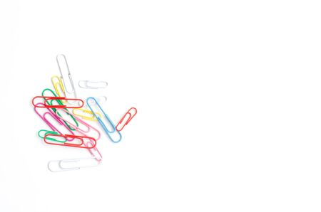 Colored paper clips on a white background.