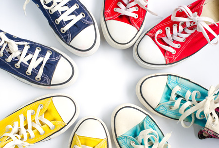 Multicolored sneakers on white background Archivio Fotografico