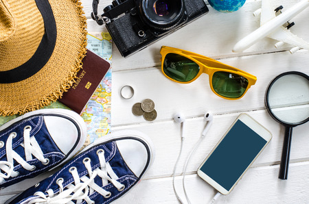 Travel accessories and costume on white background Stockfoto