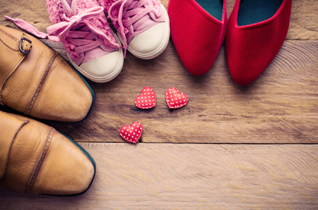 shoes, three pairs of dad, mom, daughter - the family concept