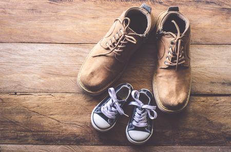 The shoes of father and son - concept takecare
