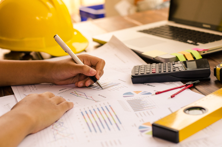 Team construction job . working with laptop in open space office. Meeting report in progress. business concept Stock Photo