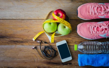 fitness concept with Exercise Equipment on wooden background. Reklamní fotografie