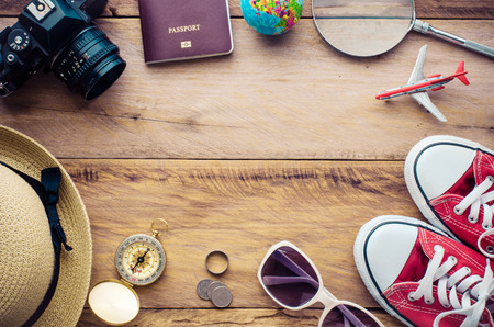Clothing and accessories for summer travel trip on wood floor