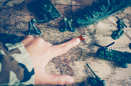 taget: Blurred images of soldiers and tactical battle troops. But focus on world map goals. Stock Photo