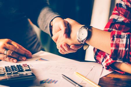 Handshake between joint venture businessmans
