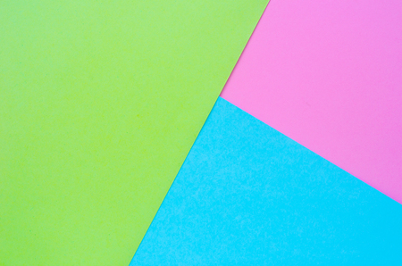 exclusive: Colorful of pink, green and blue paper background