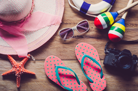 Accessories costume travel for summer on wooden floor.
