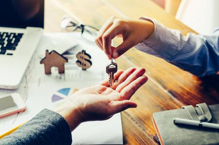 Real estate agents will give keys to tenants after the contract is completed. Stock Photo