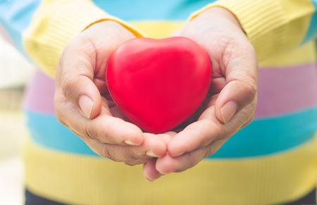Hands women giving red heart Foto de archivo
