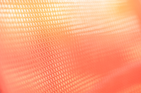 fabric orange colored background with light penetrating through