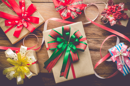 Gifts for special moments on wooden floor.  Stock Photo