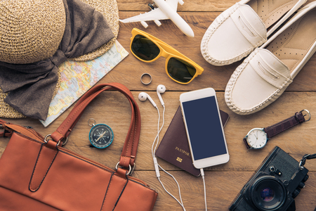 Travel accessories costumes for women. Passports, luggage, The cost of travel maps prepared for the trip Foto de archivo