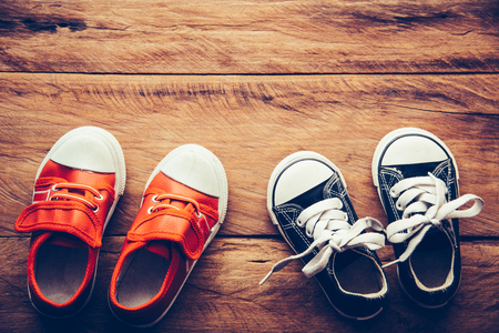 Shoes for children on wooden floor - lifestyle