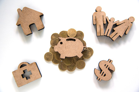 Piggy Bank Icon Set on Stack of Coins and Icon Family, Home, Dollar, Health Care - Concept of Saving Money for Daily and Future Spending Foto de archivo
