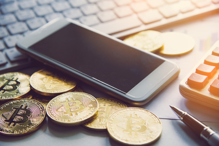 Bitcoin and its business-class laptop smartphones work and bring transactions across the network and help with todays business management, delivering fast and secure business. Foto de archivo