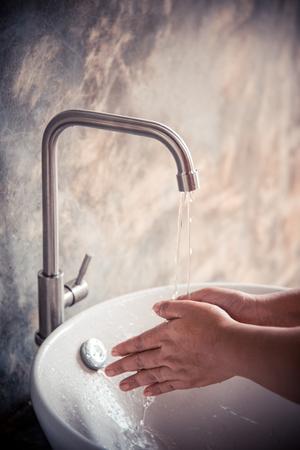 Washing hands in the sink Foto de archivo