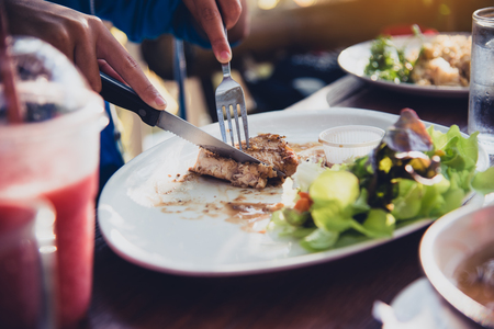 Hand hold the knife and fork for eating the steak