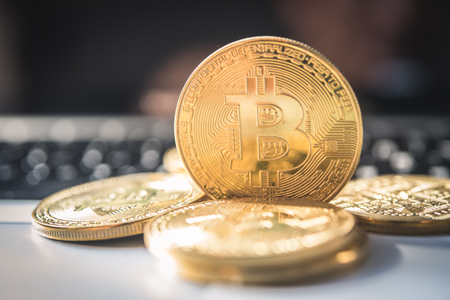 Close-up bitcoin and its business-class laptop work and bring transactions across the network and help with todays business management, Stock Photo