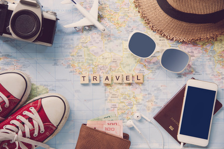 """Accessories costumes. Passports, luggage, The cost of travel maps prepared for the trip and word for """"Travel"""" on the map"""