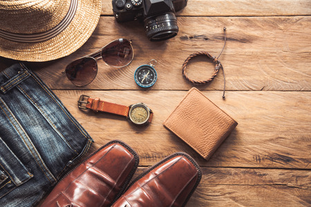 Travel Clothing accessories for men on wooden floor