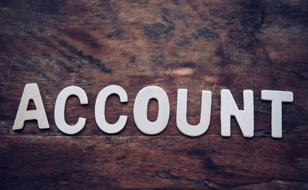 Place the word ACCOUNT white on the wooden floor. Stock Photo