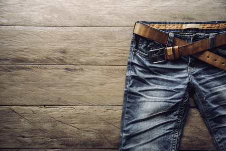 Jeans for men on a wooden floor
