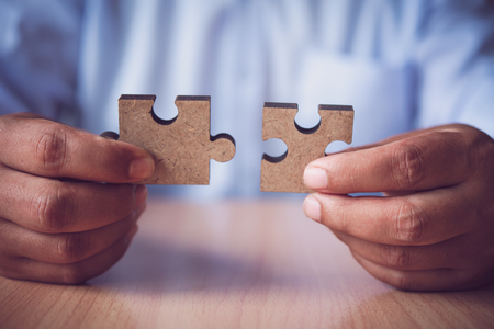 Business people are taking puzzles to connect. Ideas about building a business network. Stock Photo