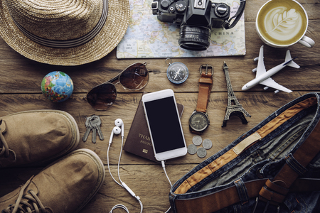 Travel accessories costumes. Passports, luggage, The cost of travel maps prepared for the trip Stock Photo